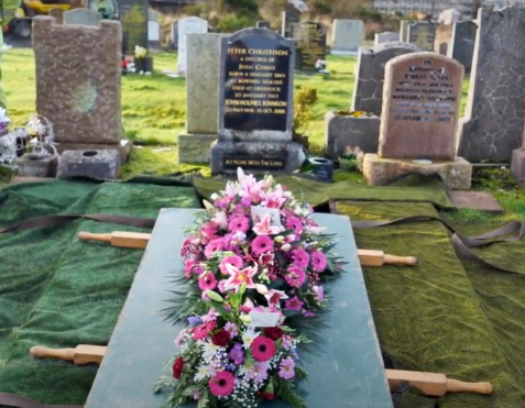 photo of flowers on grave
